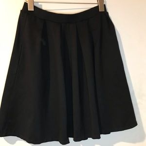 Knee length black flair skirt